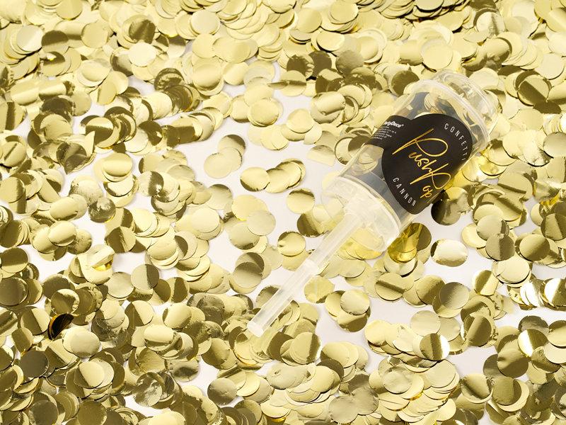 Konfeti izšaujams, zelta tonī